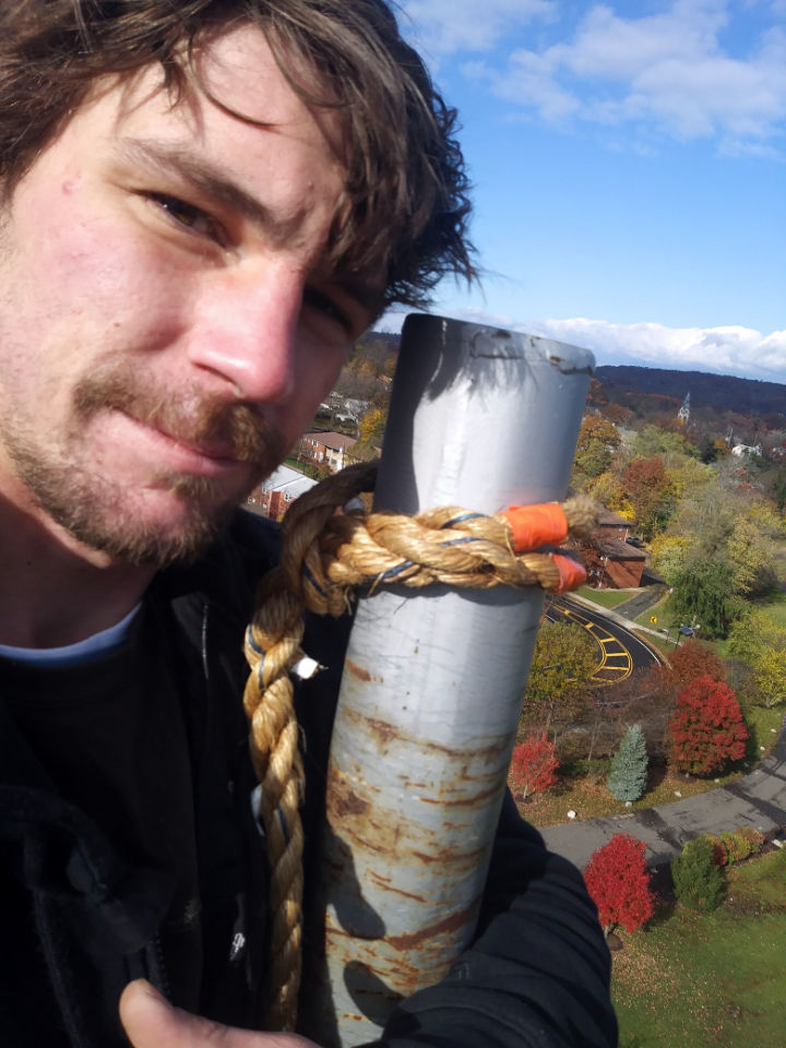 Mike Hertig - Owner Mr. Flagpole Maintenance atop a 100 foot flagpole.