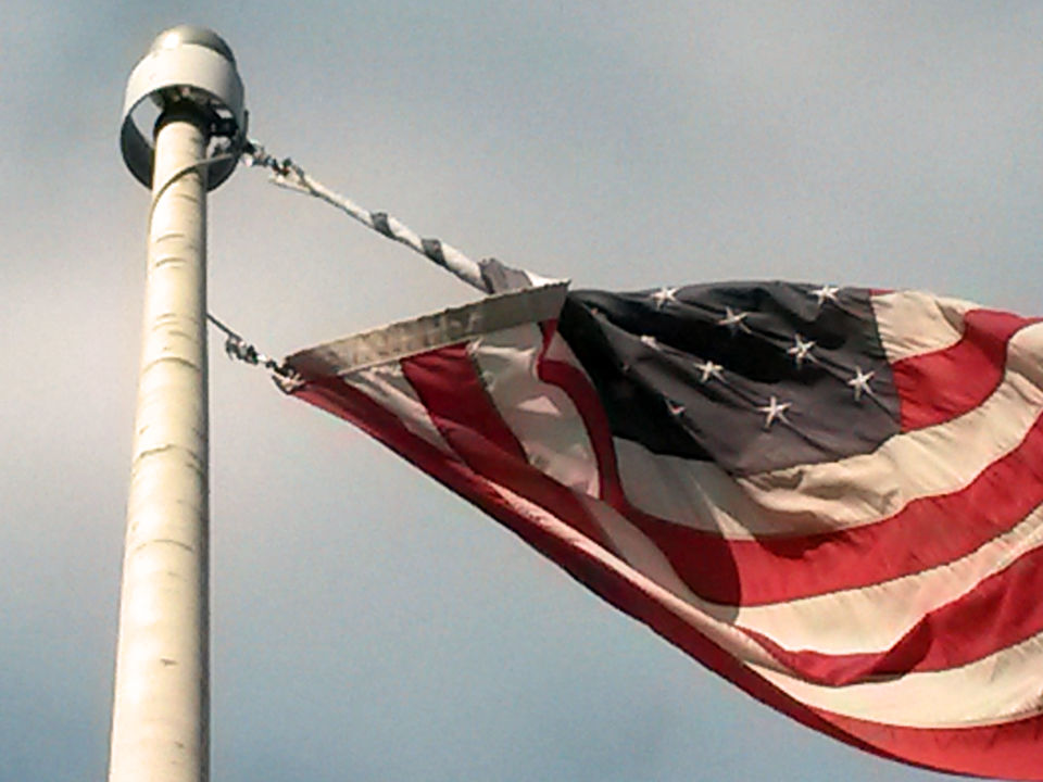 Stuck and torn flag recovery Service from Mister Flagpole Maintenance