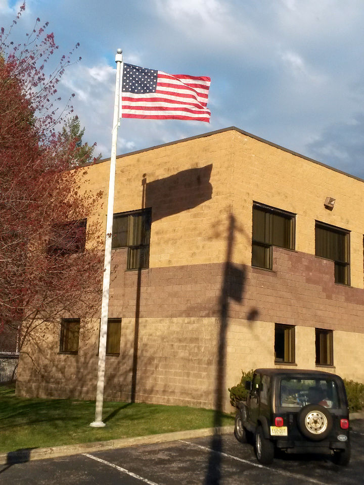 Unstuck American flag flies after being unstuck by Mr. Flagpole Maintenance