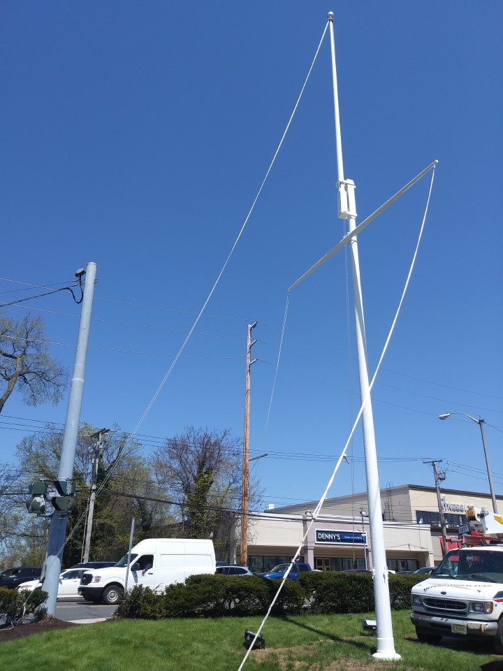 Mr. Flagpole Maintenance paints all sizes of flagpoles